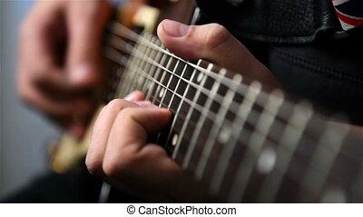 Guitarist Playing Guitar Solo An Guitar. Slow Motion Effect