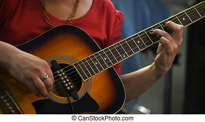 Guitarist Playing On Acoustic Guitar. Close up