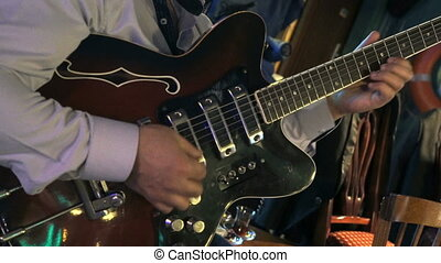 Guitarist playing on electric guitar at a concert