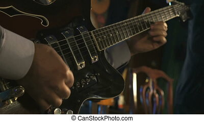 Guitarist playing on electric guitar in the club