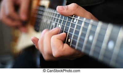 Guitarist Playing On Electrical Guitar