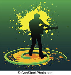 Guitarist - silhouette of a guitarist playing guitar in...