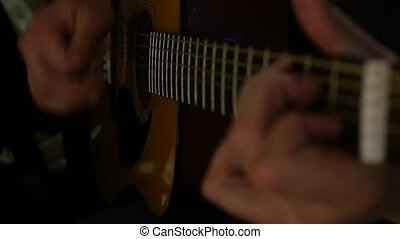 guitarist skillfully plays on a seven-stringed guitar with inspiration. 4K