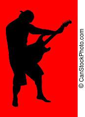 Guitarist - Musician silhouette playingthe electric guitar....