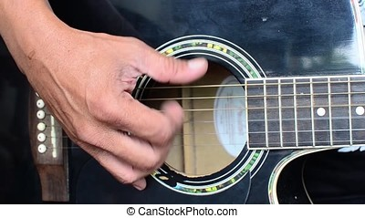 Guitarist strumming guitar - Young man strumming guitar....
