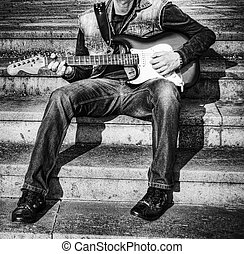 guitarist with a guitar in black and white