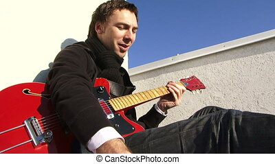 Guitarist wrote the song - A man sits on the ground plays...