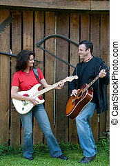 guitarists mature portrait, man and woman
