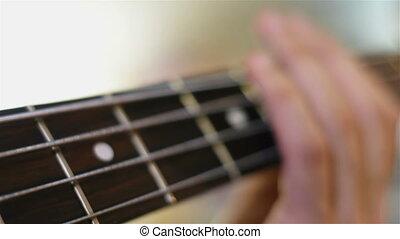 Guitarists Playing On Bass Guitar - Guitarists Hand Playing...