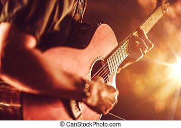 guitarra acústica, tocando
