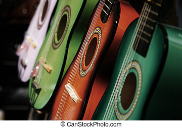 Guitars - Row of colored acoustic guitars