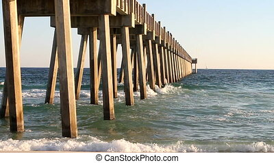 Gulf Of Mexico Pier - Gulf of Mexico surf pounds against...