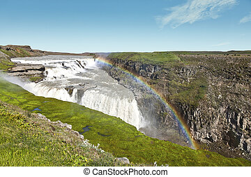 Gullfoss waterfall under a beautiful rainbow - The famous...