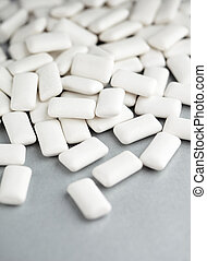 Gum - white rectangular chewing gum on grey