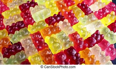 Gummy bear background. Gummy bears as texture. Gum bear...