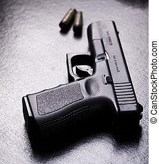 Gun - Ammunition and automatic handgun