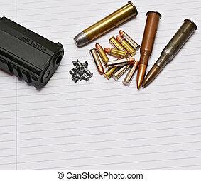 Gun and ammunition - Detail of gun and ammunition, handgun...