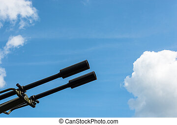 The gun barrel against cloudy sky close-up shot.
