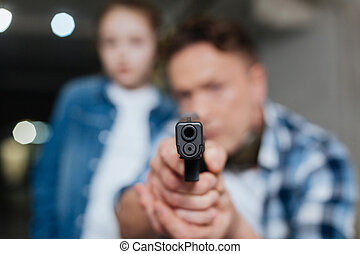 Gun barrel being pointed at you