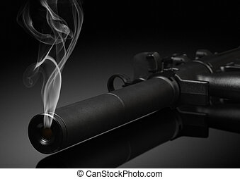 gun barrel with smoke on black background
