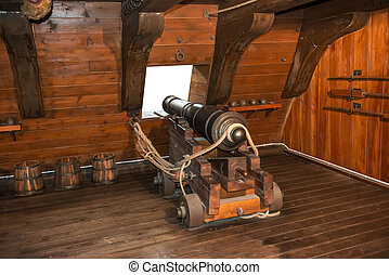 Gun cannon on vintage sailing ship