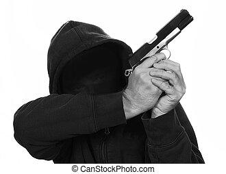 Gun Crime - masked man holds gun is aiming up