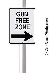 Gun Free Zone - Modified one way sign indicating gun free...
