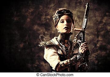 gun grunge - Portrait of a beautiful steampunk woman holding...