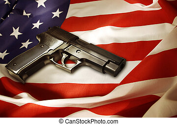 Gun - Handgun lying on American flag
