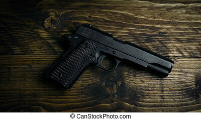 Gun Is Placed On Table Overhead Shot - Gun is put down on...
