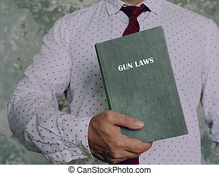 GUN LAWS phrase on the book. Gun control is one of the most divisive issues in American?politics.