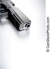 gun on highkey brushed metal background. closeup, focus on front.