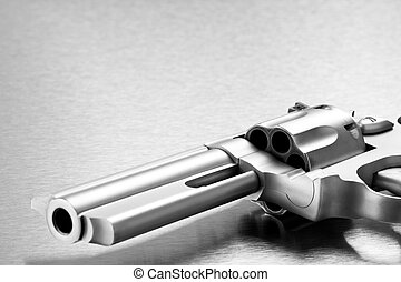 gun on metal - modern revolver - handgun on steel background...
