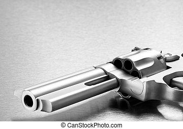 handgun on steel background - modern revolver closeup with copyspace. Focus on cylinder.
