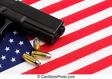 gun over american flag, modern 9mm handgun with bullets