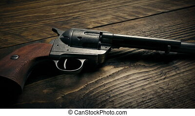 Gun Picked Up In Wild West - Hand gun taken off table in...