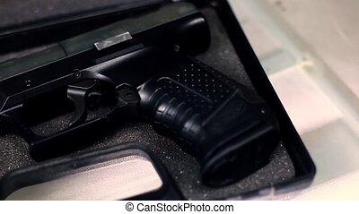Gun pistol in case with ammo