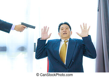 gun pointing to business man