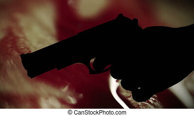 Gun silhouette against bloody background crime concept