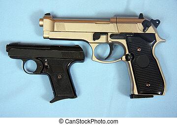 gun on blue background