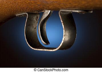 Gun trigger - Trigger of a rifle back lit by blue spot