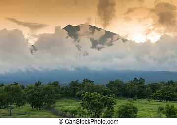 Gunung Agung volcano in Bali - Sunset over Volcano Gunung...
