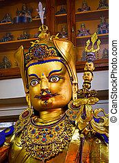 Gilded statue of Guru Padmasambhava in Tsuglagkhang temple. McLeod Ganj, Himachal Pradesh, India