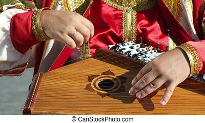 Gusli folk musical Russian instrument in men's hands...