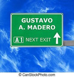 GUSTAVO A. MADERO  road sign against clear blue sky