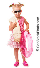 Gute little blond girl with sunglasses, towel and inflatable ring on white.