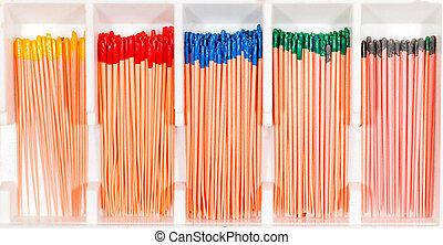 Gutta percha pellets - Many arranged gutta percha pellets in...