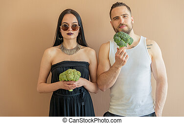 Guy and girl with broccoli