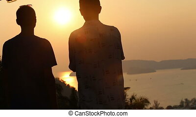 guy and old man look at the sunset