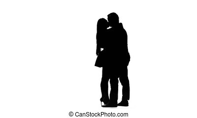 Guy and the girl are kissing. Silhouette. White background